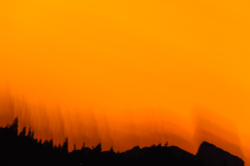 An abstract sunset over a Ridgeline with trees