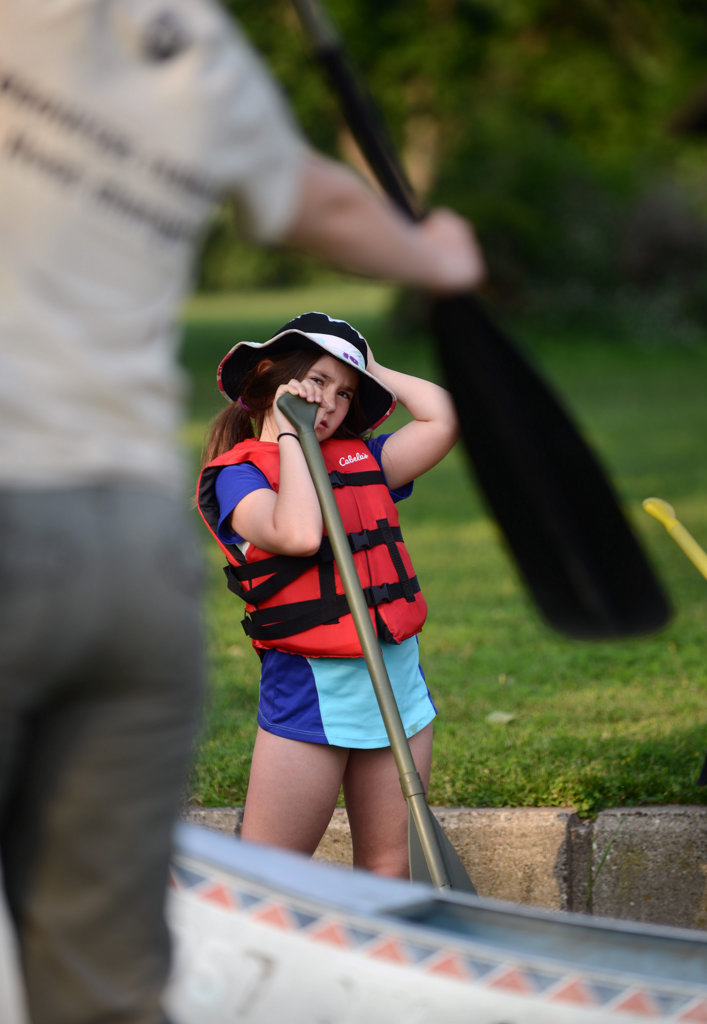 . A child tries to follow instructions for the various paddle strokes. (Pioneer Press: Chris Polydoroff)