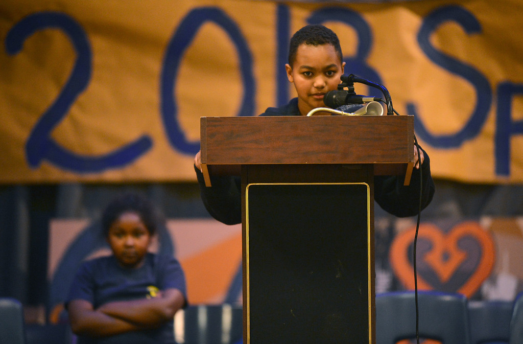 """. Sankofa Academy sixth-grader Adam Ansari steps to the microphone to spell \""""defunct\"""" and thereby take first place in the school\'s second annual spelling bee in Oakland, Calif. on Wednesday, Jan. 23, 2013. Adam will move on to represent Sankofa\'s middle school class at the district level spelling bee in February. (Kristopher Skinner/Staff)"""