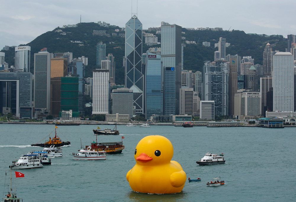 . A giant Rubber Duck created by Dutch artist Florentijn Hofman is towed along Hong Kong\'s Victoria Habour Thursday, May 2, 2013. Since 2007 the 16.5-meter (54-foot)-tall Rubber Duck has traveled to various cites including Osaka, Sydney, Sao Paulo and Amsterdam. (AP Photo/Vincent Yu)