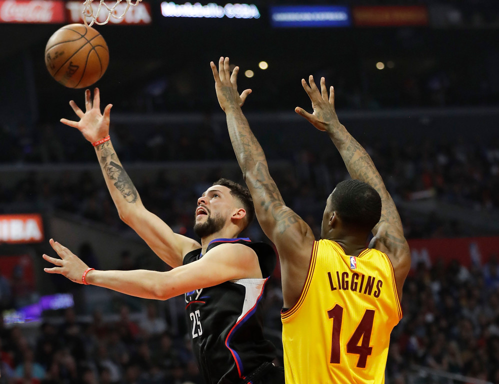 . Los Angeles Clippers\' Austin Rivers, left, shoots past Cleveland Cavaliers\' DeAndre Liggins during the first half of an NBA basketball game Saturday, March 18, 2017, in Los Angeles. (AP Photo/Jae C. Hong)