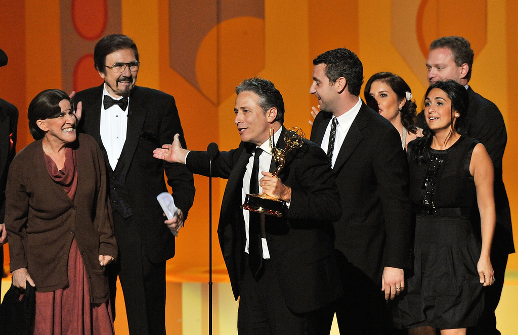 """. TV host Jon Stewart (C) accepts the Outstanding Variety, Music or Comedy Series award for \""""The Daily Show With Jon Stewart\""""onstage during the 60th Primetime Emmy Awards held at Nokia Theatre on September 21, 2008 in Los Angeles, California.  (Photo by Kevin Winter/Getty Images)"""
