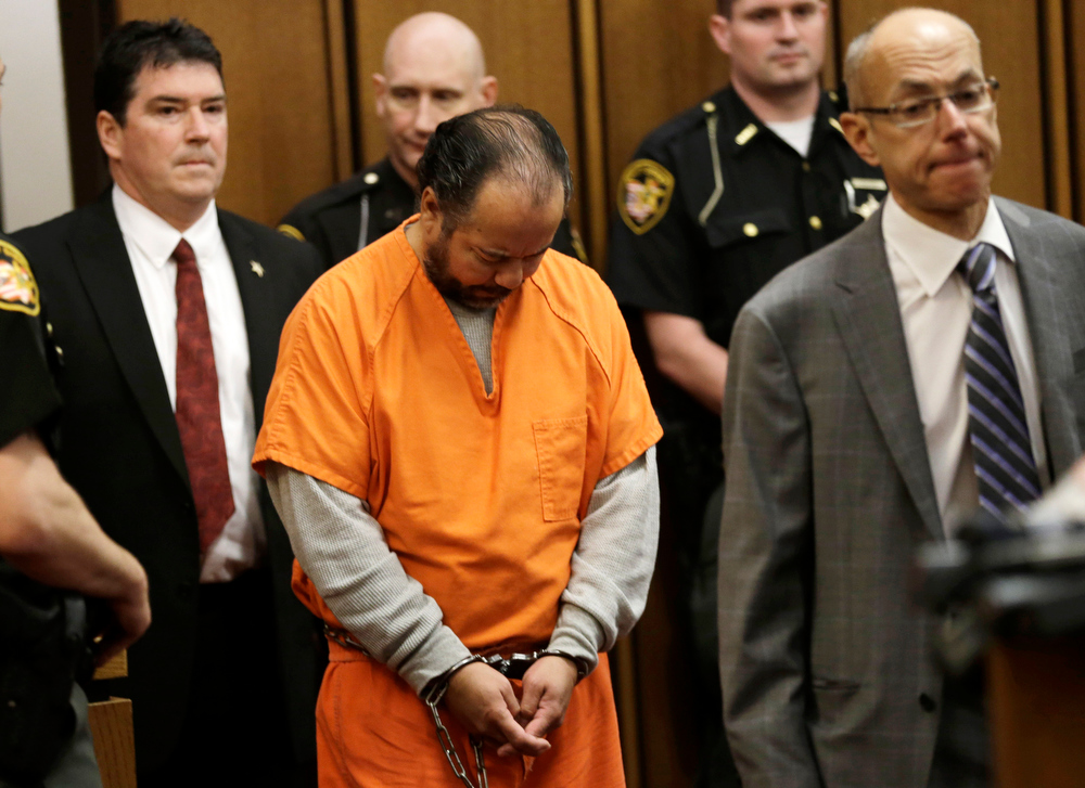 . Ariel Castro, center, enters the courtroom for his arraignment Wednesday, June 12, 2013, in Cleveland. Castro, who held 3 women captive for a decade, has committed suicide, Tuesday, Sept. 3, 2013. (AP Photo/Tony Dejak)