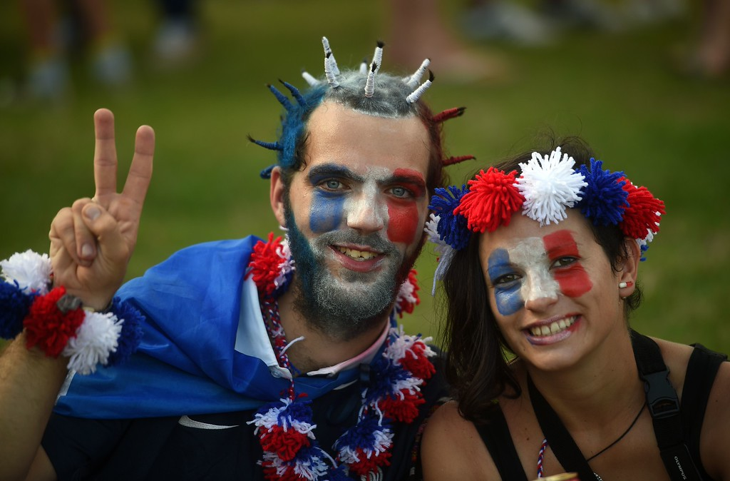 . France fans pose as they arrive for the Group E football match between Switzerland and France at the Fonte Nova Arena in Salvador during the 2014 FIFA World Cup on June 20, 2014.  AFP PHOTO / DIMITAR DILKOFF/AFP/Getty Images