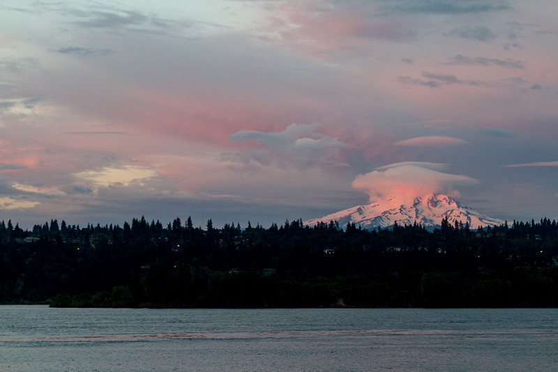 Mount Hood bathed in the pink light of sunrise and topped by a cloud - Oregon - USA