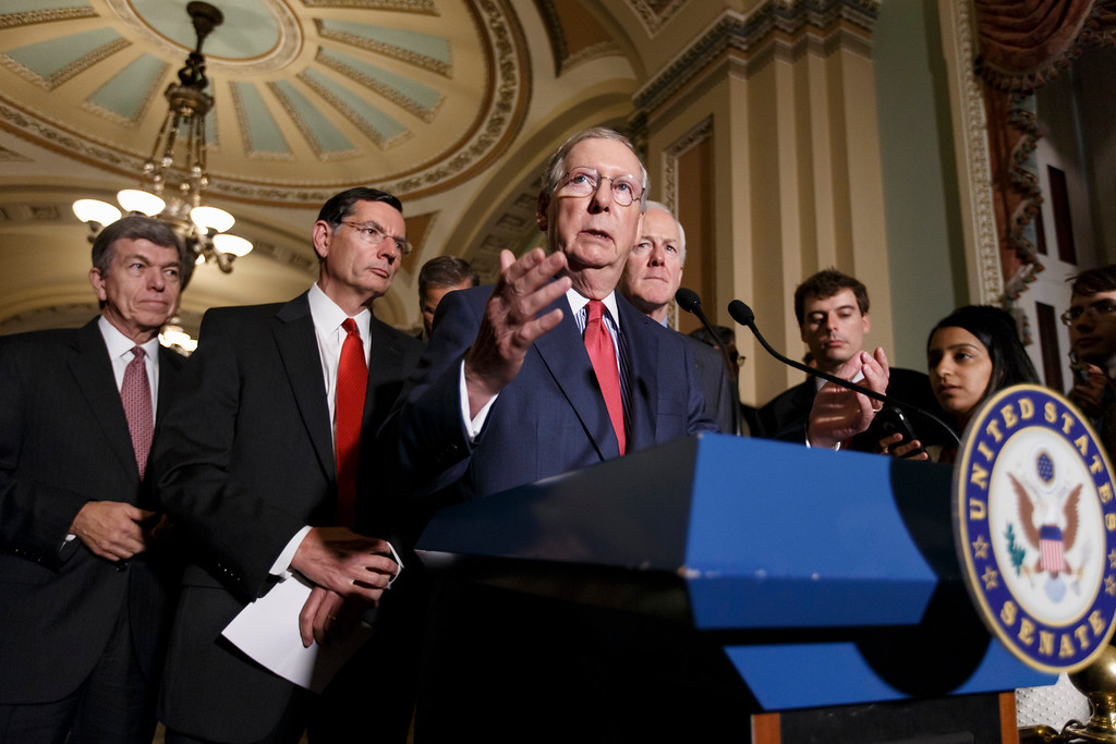 """. Senate Minority Leader Mitch McConnell of Ky., center, says it\'s time for President Barack Obama to \""""exercise some leadership in launching a response\"""" to the Islamic State militants in Iraq and Syria, Tuesday, Sept. 9, 2014, during a news conference on Capitol Hill in Washington following a GOP caucus meeting. From left are, Sen. Roy Blunt, R-Mo., Sen. John Barrasso, R-Wyo., the Republican Policy Committee chairman, McConnell, and Senate Minority Whip John Cornyn of Texas. McConnell spoke in advance of a White House meeting this afternoon between the president and congressional leaders from both parties. (AP Photo/J. Scott Applewhite)"""