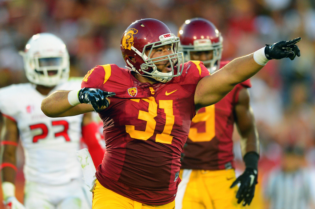 . USC FB Soma Vainuku celebrates his 11-yard touchdown run in the third-quarter against Fresno State, Saturday, August 30, 2014, at the L.A. Memorial Coliseum. (Photo by Michael Owen Baker/Los Angeles Daily News)
