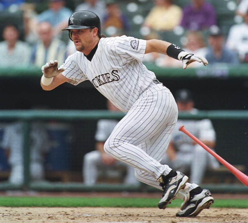 . Colorado Rockies\' Larry Walker breaks from the batter\'s box after laying down a bunt single on a pitch from Cincinnati Reds\' Mike Remlinger in the fifth inning of the Rockies\' 6-4 victory in game one of a day-night doubleheader in Denver\'s Coors Field on Thursday, July 23, 1998. (AP Photo/David Zalubowski)