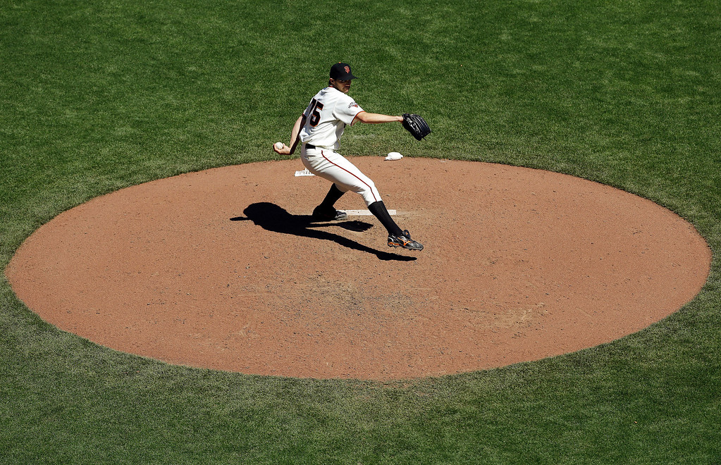 . San Francisco Giants pitcher Barry Zito (75) delivers against the Colorado Rockies during the sixth inning of a baseball game in San Francisco, Wednesday, April 10, 2013. (AP Photo/Jeff Chiu)
