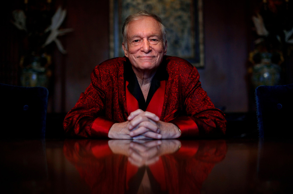 . FILE - In this Nov. 4, 2010, file photo, Playboy magazine founder Hugh Hefner poses for photos at the Playboy Mansion in Los Angeles. The Playboy magazine founder and sexual revolution symbol Hefner has died at age 91. The magazine released a statement saying Hefner died at his home of natural causes on Wednesday night, Sept. 27, 2017, surrounded by family. (AP Photo/Jae C. Hong, File)