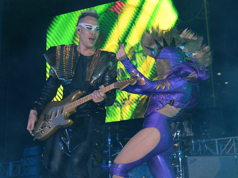 . Recording artist Luke Steele (L) of Empire of the Sun performs with a dancer at the 17th annual Electric Daisy Carnival at Las Vegas Motor Speedway on June 22, 2013 in Las Vegas, Nevada.  (Photo by Ethan Miller/Getty Images)