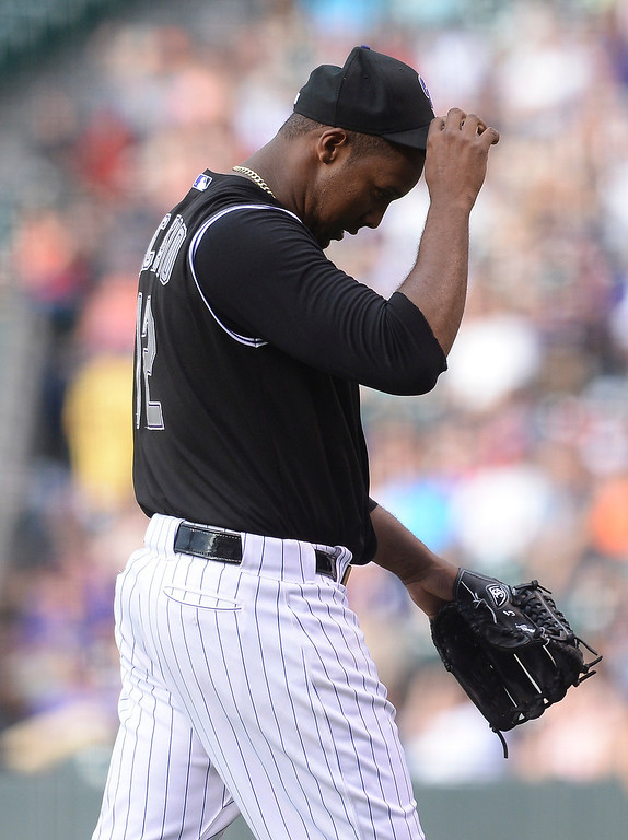 . Colorado starter Juan Nicasio walked to the dugout after completing a disastrous first inning. Nicasio gave up seven runs including a grand slam to Atlanta hitter Andrelton Simmons. The Colorado Rockies hosted the Atlanta Braves Tuesday night, June 10, 2014. (Photo by Karl Gehring/The Denver Post)