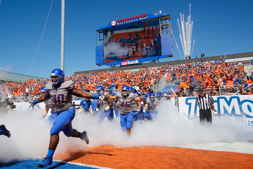 . Boise State defensive tackle Armand Nance (40) and teammates run onto the field for an NCAA college football game against Tennessee-Martin in Boise, Idaho, Saturday, Sept. 7, 2013. (AP Photo/Otto Kitsinger)