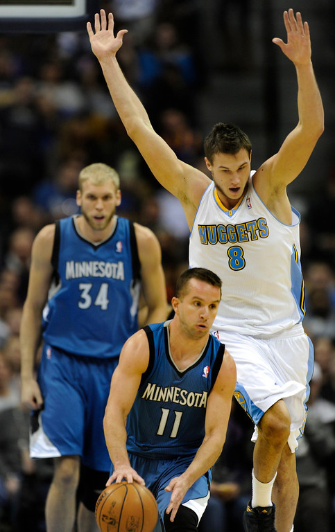. Denver forward Danilo Gallinari (8) trailed Wolves guard Jose Barea (11) as he started a break in the first half. The Denver Nuggets hosted the Minnesota Timberwolves at the Pepsi Center Thursday night, January 3, 2013. Karl Gehring/The Denver Post