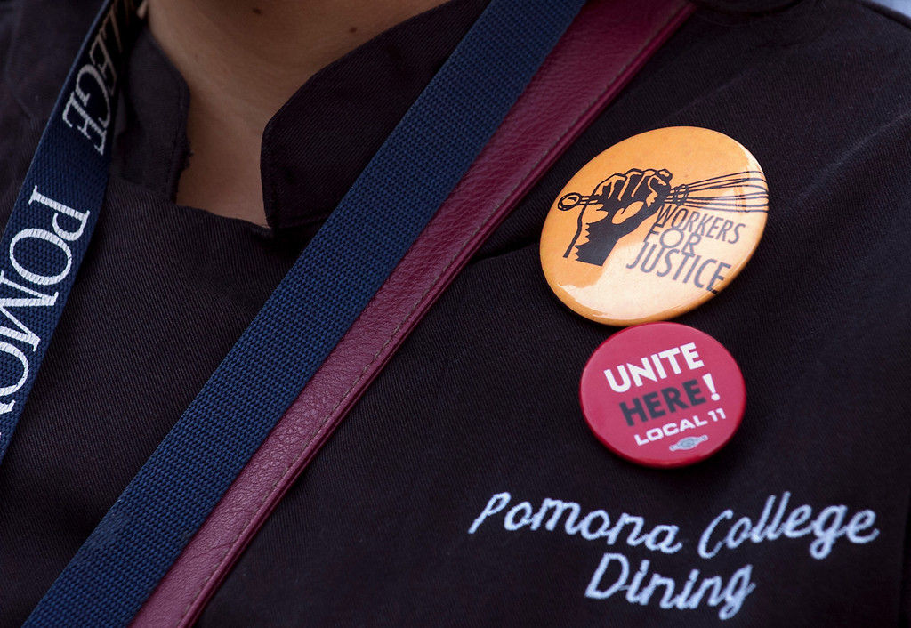. 0404_NWS_IDB_L-RALLY-02-JCM (Jennifer Cappuccio Maher/Staff Photographer) Buttons of support as Pomona College dining hall workers and students hold a rally to announce a plan to file for a union election Wednesday, April 3, 2013, at Pomona College in Claremont.