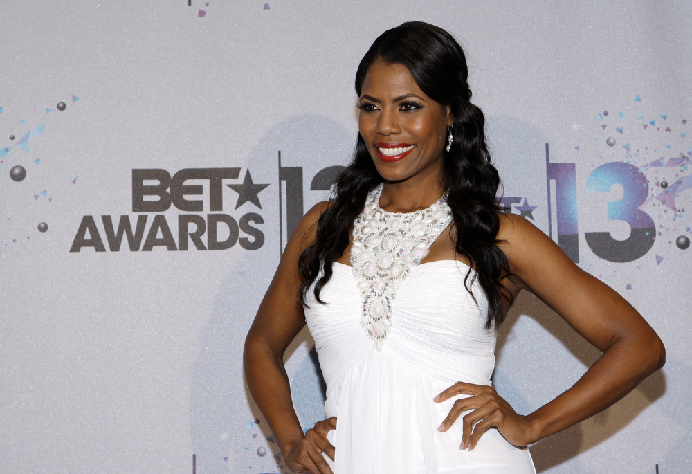 Description of . TV personality Omarosa Manigault poses in the Backstage Winner's Room at Nokia Theatre L.A. Live on June 30, 2013 in Los Angeles, California.  (Photo by Mike Windle/Getty Images for BET)
