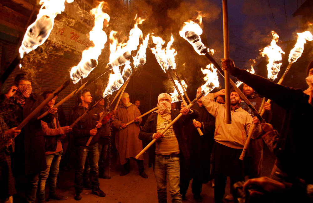 Description of . Activists and supporters of Jammu and Kashmir Liberation Front (JKLF) hold torches as they participate in a protest march to mark International Human Rights Day in Srinagar, India, Monday, Dec. 10, 2012. More than 68,000 people, mostly civilians, have been killed since the outbreak of the insurgency in the region in 1989. Pakistan, Kashmiri separatist leaders and human rights groups have been demanding a reduction in India's military presence in Kashmir. (AP Photo/Mukhtar Khan)
