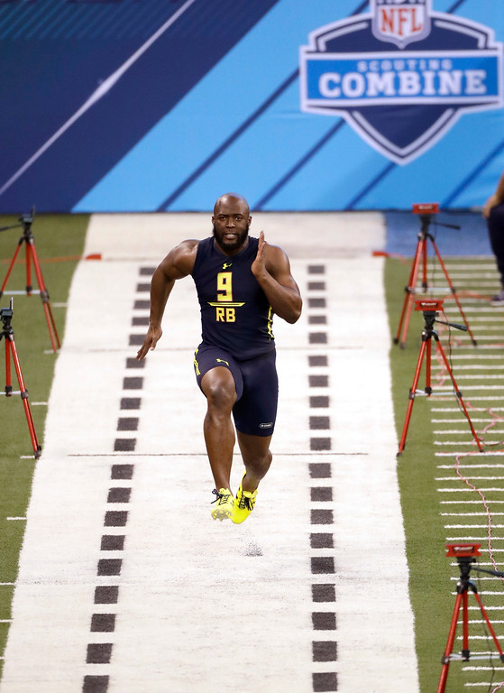 . LSU running back Leonard Fournette runs the 40-yard dash at the NFL football scouting combine Friday, March 3, 2017, in Indianapolis. (AP Photo/David J. Phillip)