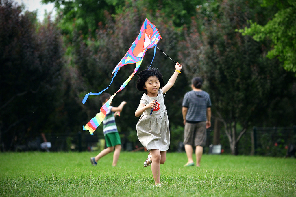 . A girl flies a kite at a park  in Beijing on June 1, 2013 . Tens of thousands of children celebrate the International Children\'s Day in China. WANG ZHAO/AFP/Getty Images