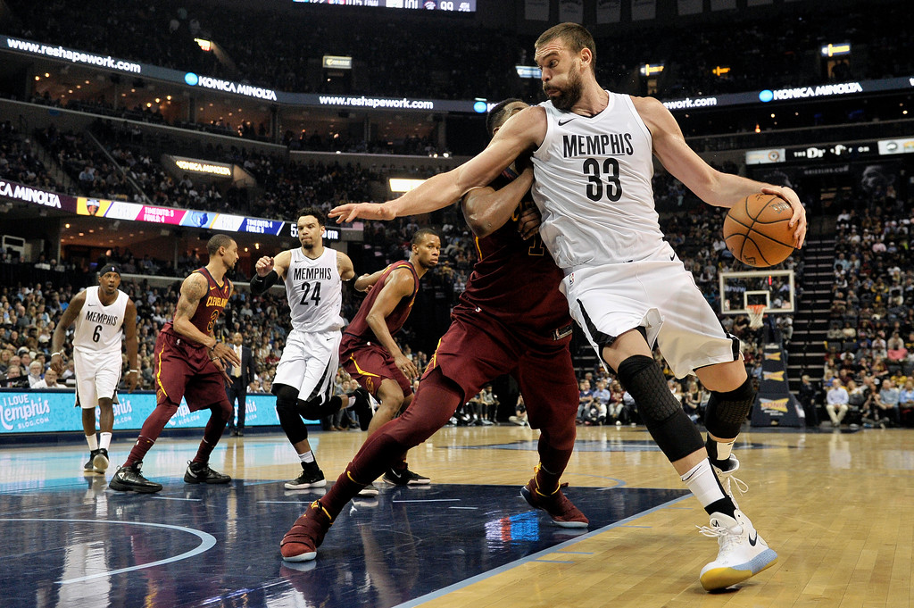 . Memphis Grizzlies center Marc Gasol (33) drives against against Cleveland Cavaliers center Tristan Thompson during the second half of an NBA basketball game Friday, Feb. 23, 2018, in Memphis, Tenn. (AP Photo/Brandon Dill)