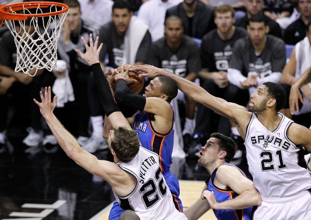 . Russell Westbrook #0 of the Oklahoma City Thunder goes up for a shot as Tim Duncan #21 of the San Antonio Spurs goes to block it from behind in Game One of the Western Conference Finals during the 2014 NBA Playoffs at AT&T Center on May 19, 2014 in San Antonio, Texas.  (Photo by Chris Covatta/Getty Images)