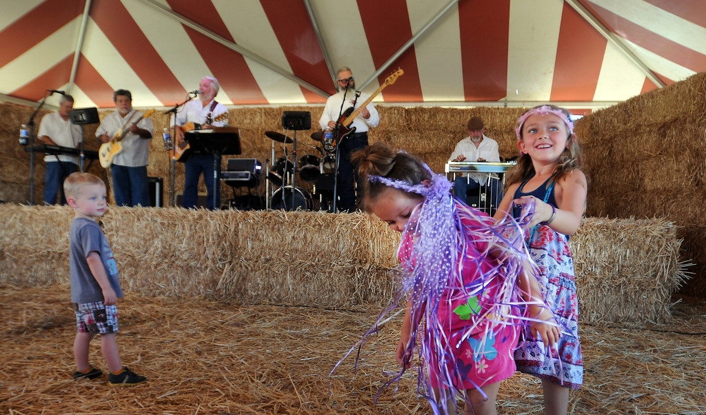 """. Owen O\'Neal, 3, Avery Westerfield, 3, and Riley Westerfield, 6, all from Simi Valley, enjoy the \""""Sweet Country\"""" band.  Underwood Family Farms in Moorpark, CA hosted its Friends of the Farm weekend, launching its Fall Harvest Festival, which runs through Halloween.  The Saturday, September 28, 2013, event benefits the Ventura County Sheriff\'s & Fire Departments.  (Photo by Dean Musgrove/Los Angeles Daily News)"""