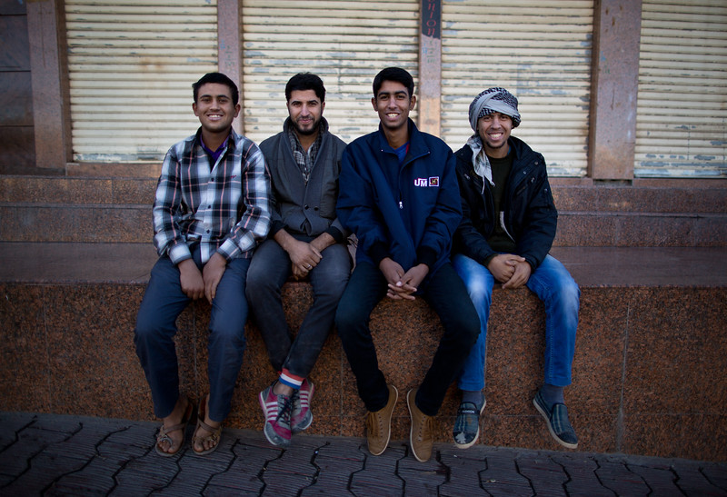 Four Iraqi Kurds posing for a photo in Sulaymaniyah, Iraqi Kurdistan.
