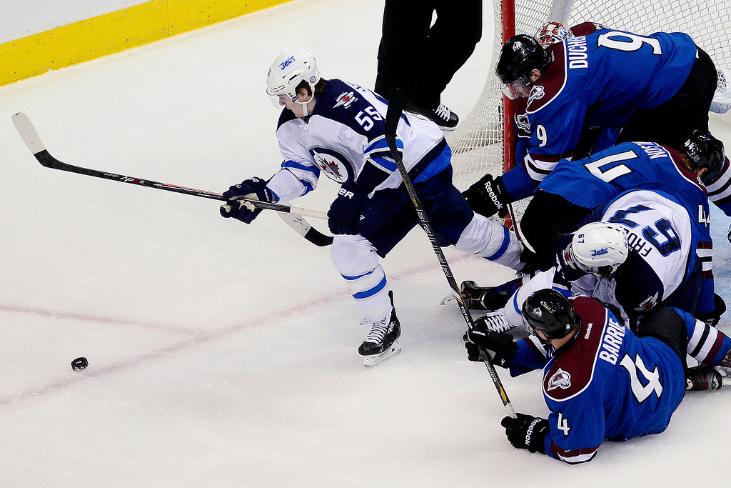 . Mark Scheifele (55) of the Winnipeg Jets escapes a pile of players to control the puck during the second period of action.   (Photo by AAron Ontiveroz/The Denver Post)