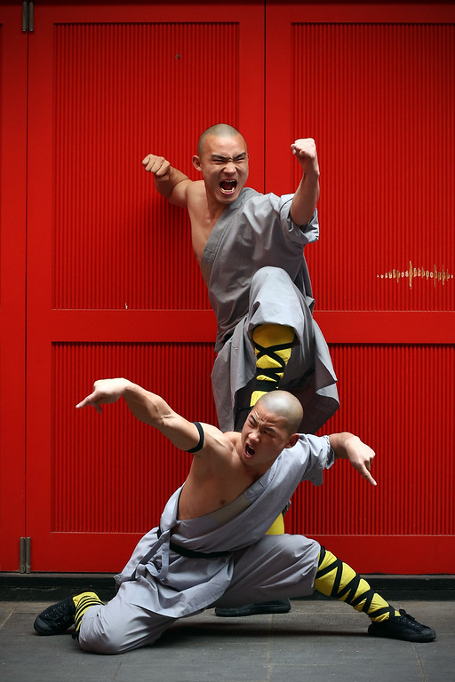 . LONDON, ENGLAND - FEBRUARY 23:  Shaolin monks pose for a photograph in Chinatown on February 23, 2015 in London, England. The monks practice Shaolin Kung Fu which is believed to be the oldest institutionalised style of kung fu and are demonstrating their skills while in the UK.  (Photo by Carl Court/Getty Images)