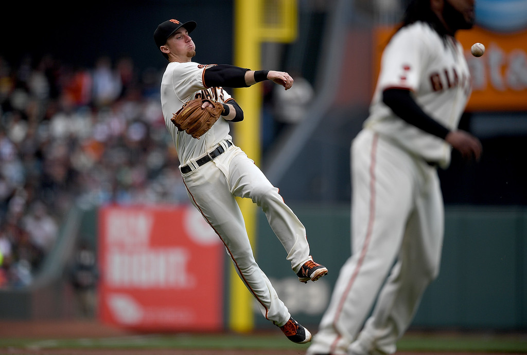 . SAN FRANCISCO, CA - MAY 07:  Matt Duffy #5 of the San Francisco Giants makes an off balance throw to first base but not in time to get Gerardo Parra #8 of the Colorado Rockies in the top of the seventh inning at AT&T Park on May 7, 2016 in San Francisco, California.  (Photo by Thearon W. Henderson/Getty Images)