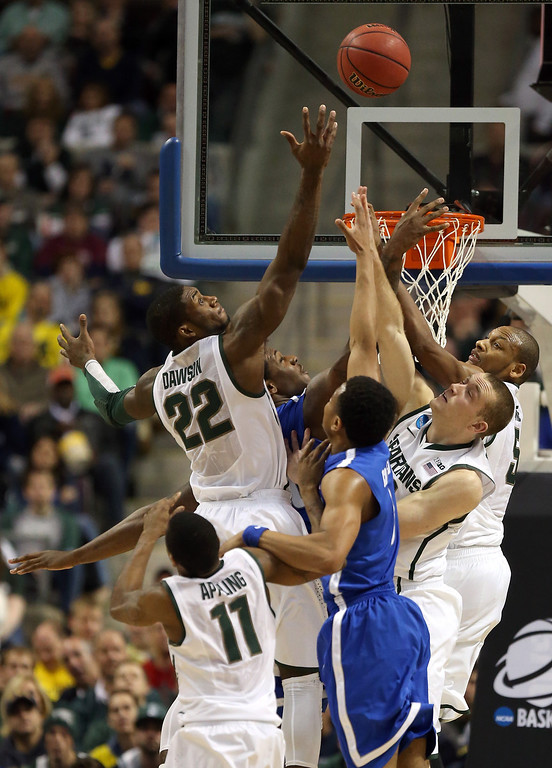 . AUBURN HILLS, MI - MARCH 23:  Branden Dawson #22 of the Michigan State Spartans reaches for the ball in the second half against the Memphis Tigers during the third round of the 2013 NCAA Men\'s Basketball Tournament at The Palace of Auburn Hills on March 23, 2013 in Auburn Hills, Michigan.  (Photo by Jonathan Daniel/Getty Images)