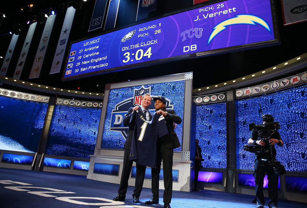 . Jason Verrett of the TCU Horned Frogs poses with NFL Commissioner Roger Goodell after he was picked #25 overall by the San Diego Chargers during the first round of the 2014 NFL Draft at Radio City Music Hall on May 8, 2014 in New York City.  (Photo by Elsa/Getty Images)