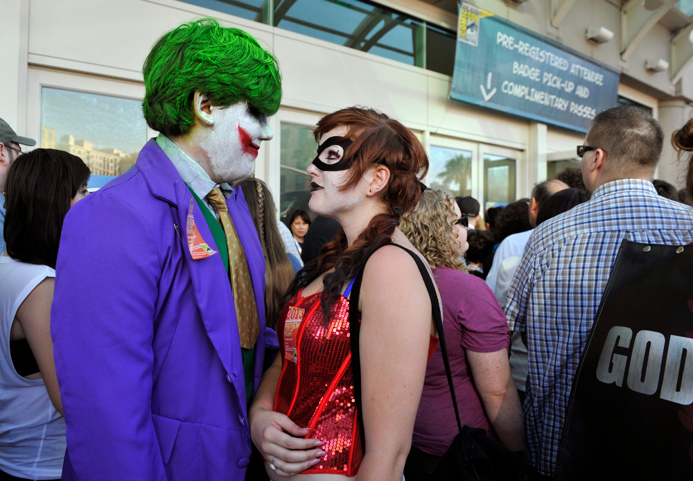 . Ernesto Solis, left, and Michelle Repinski, both of San Diego, Calif, wait to get admitted to the Preview Night event on Day 1 of the 2013 Comic-Con International Convention on Wednesday, July 17, 2013 in San Diego, Calif. (Photo by Chris Pizzello/Invision/AP)