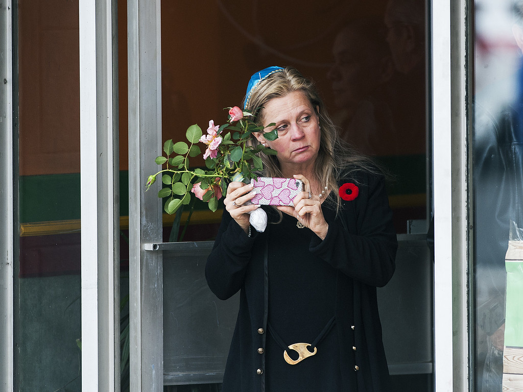 . A woman watches the funeral procession for Cpl. Nathan Cirillo at the Christ\'s Church Cathedral on October 28, 2014 in Hamilton, Ontario, Canada.  (Photo by Aaron Vincent Elkaim/Getty Images)