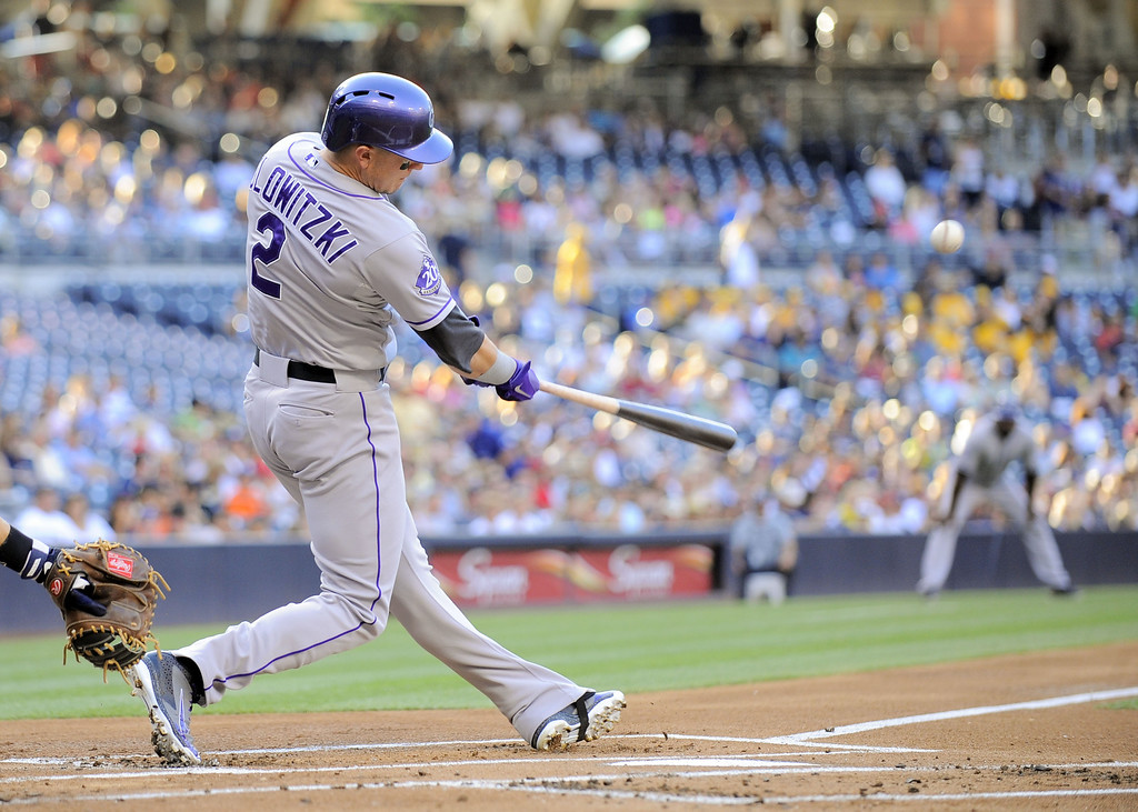 . SAN DIEGO, CA - SEPTEMBER 7:  Troy Tulowitzki #2 of the Colorado Rockies hits a single during the first inning of a baseball game against the San Diego Padres at Petco Park on September 7, 2013 in San Diego, California.  (Photo by Denis Poroy/Getty Images)