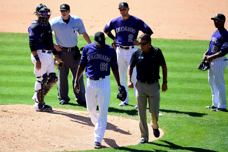 . Colorado Rockies relief pitcher Edgmer Escalona (61) leaves the field after being pulled in the seventh against the San Diego Padres during the action in Denver. The Colorado Rockies hosted the San Diego Padres at Coors Field on Sunday, June 9, 2013. (Photo by AAron Ontiveroz/The Denver Post)