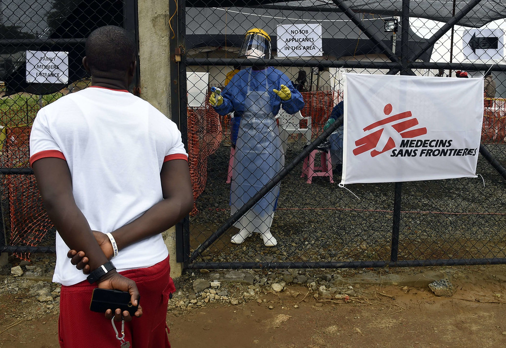 . A man asks a health worker about his wife being treated at the medical centre of Doctor Without Borders (Medecin sans Frontiere (MSF) where people infected with the Ebola virus are treated in Monrovia on September 26, 2014. Thousands of doses of experimental Ebola vaccines could be ready for use in African countries badly hit by the deadly virus early next year, the World Health Organization said. PASCAL GUYOT/AFP/Getty Images