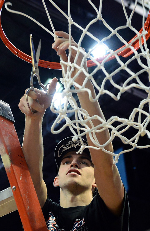 . David Stockton #11 of the Gonzaga Bulldogs cuts down a net after the championship game of the West Coast Conference Basketball tournament at the Orleans Arena on March 11, 2014 in Las Vegas, Nevada. Gonzaga won 75-64.  (Photo by Ethan Miller/Getty Images)