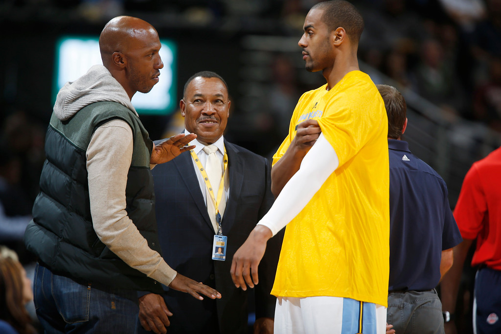 . Retired Detroit Pistons guard Chauncey Billups, left, who lives in his hometown of Denver, chats with Robert Simmons, center, a member of the Denver Nuggets security team, and Nuggets guard Arron Afflalo at halftime during an NBA basketball game in Denver on Wednesday, Oct. 29, 2014. (AP Photo/David Zalubowski)