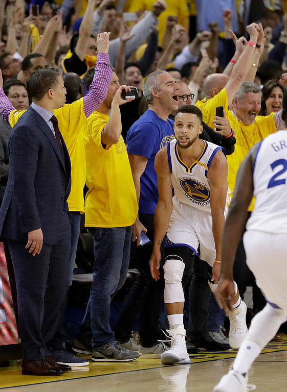 . Golden State Warriors guard Stephen Curry (30) reacts after scoring against the Cleveland Cavaliers during the second half of Game 5 of basketball\'s NBA Finals in Oakland, Calif., Monday, June 12, 2017. The Warriors won 129-120 to win the NBA championship. (AP Photo/Marcio Jose Sanchez)