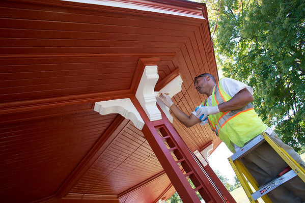 09/19/19 Wesley Bunnell | StaffrrCity workers were busy making improvements to Walnut Hill Park on Thursday as well as setting up security measures for the expected crowd for Sunday's visit by the Polish President. City worker Benny Morales applies a fresh coat of red paint with white trim on the gazebo in the park.