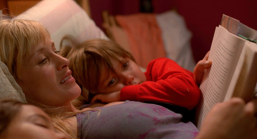 """. This image released by IFC Films shows Patricia Arquette and Ellar Coltrane in a scene from the film,\""""Boyhood.\"""" Arquette was nominated for a Golden Globe for best supporting actress in a drama for her role in the film on Thursday, Dec. 11, 2014. The 72nd annual Golden Globe awards will air on NBC on Sunday, Jan. 11.  (AP Photo/IFC Films)"""