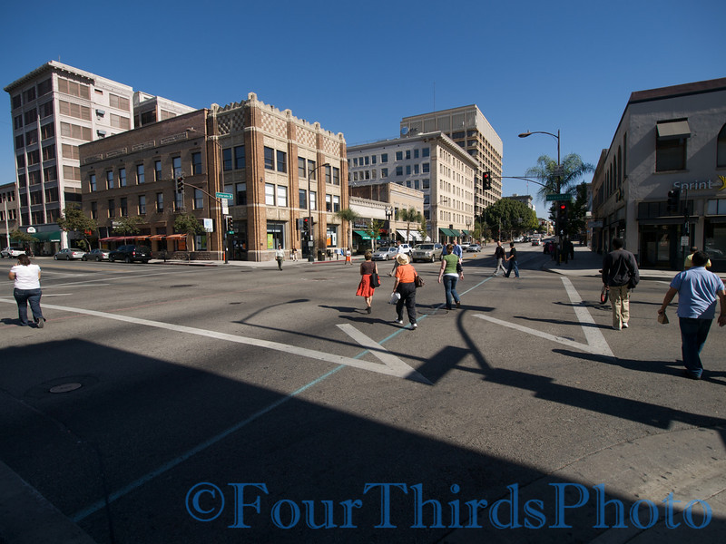 a snap shot of people crossing the street in Pasadena.