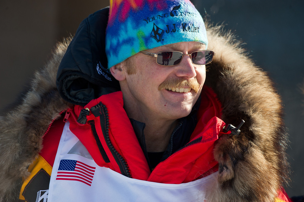 . Defending champion Mitch Seavey talks with others before the Iditarod Trail Sled Dog Race got under way Sunday, March 2, 2014, in Willow, Alaska. (AP Photo/Anchorage Daily News, Marc Lester)