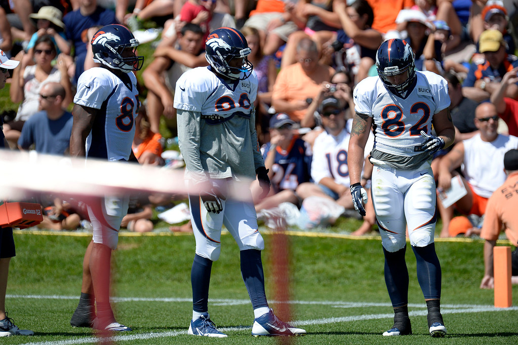 . Denver Broncos TE\'s Virgil GReen (85) Julius Thomas (80) and Jake O\'Connell take a break from drills during training camp August 5, 2013 at Dove Valley. (Photo By John Leyba/The Denver Post)