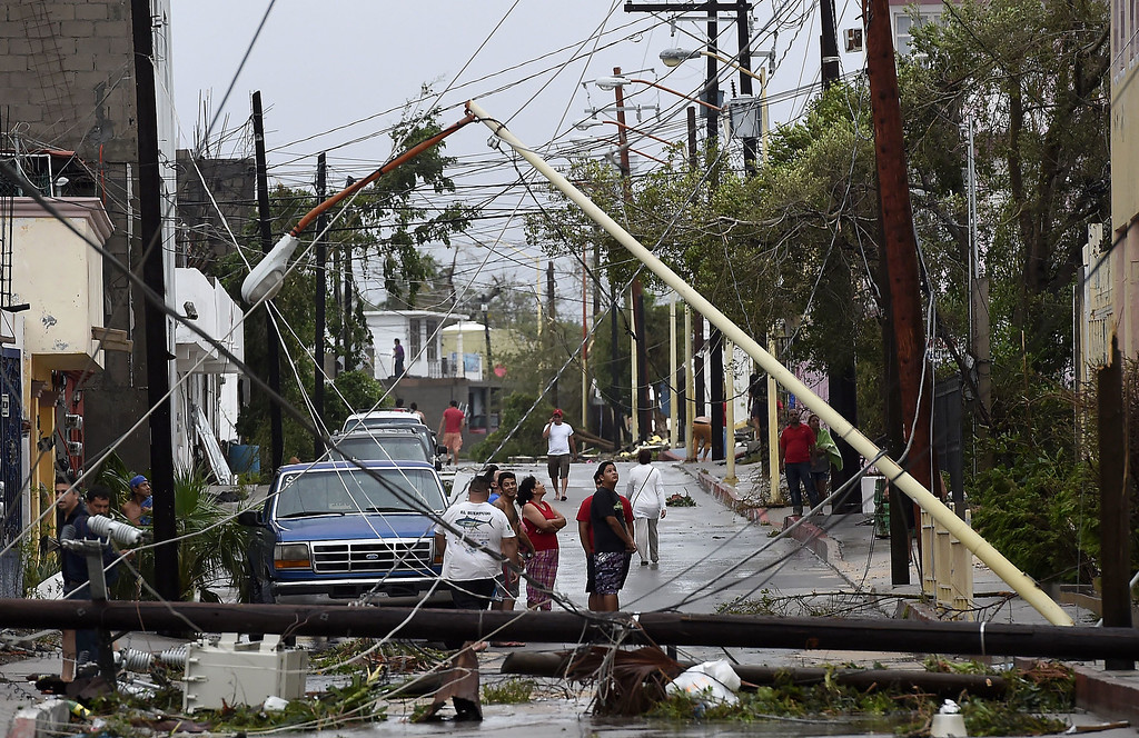 . People look at the destruction after hurricane Odile knocked down trees and power lines in Cabo San Lucas, in Mexico\'s Baja California peninsula, on September 15, 2014.  AFP PHOTO/RONALDO SCHEMIDT/AFP/Getty Images