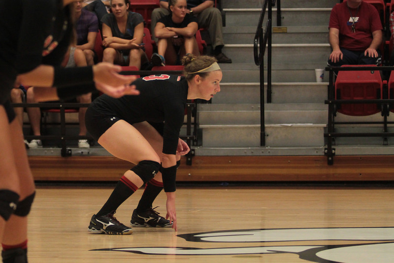 Number 3, Chelsea Hearne, prepares for the serve.