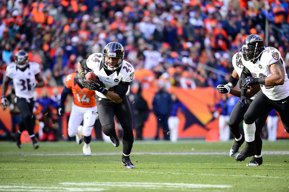 . Baltimore Ravens cornerback Corey Graham (24) returns an interception for a 39-yard touchdown in the first quarter. The Denver Broncos vs Baltimore Ravens AFC Divisional playoff game at Sports Authority Field Saturday January 12, 2013. (Photo by AAron  Ontiveroz,/The Denver Post)
