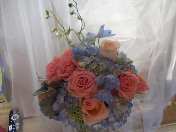 Blue hydrangea, peach roses $55