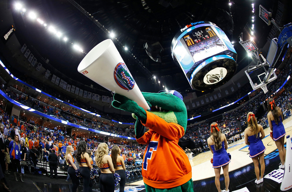 . The Florida mascot cheers before the first half in a regional semifinal game against UCLA at the NCAA college basketball tournament, Thursday, March 27, 2014, in Memphis, Tenn. (AP Photo/John Bazemore)
